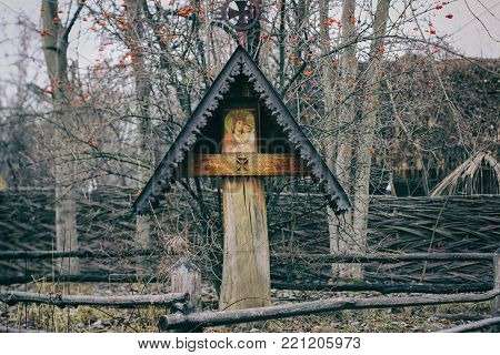 Religious wooden statues of Cyril and Methodius with the Double Slovak Cross. slavic cross wooden cross, icon on the cross, Christianity