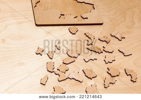 Wooden puzzles lie on a wooden table