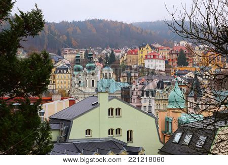 Cityscape with Saint Mary Magdalene church (Karlovy Vary). Famous Czech Spa Karlovy Vary (Karlsbad) in the late autumn time. poster