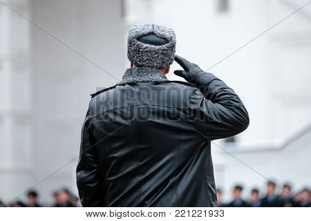 Russian army general. Salutation. Back view. Winter view.