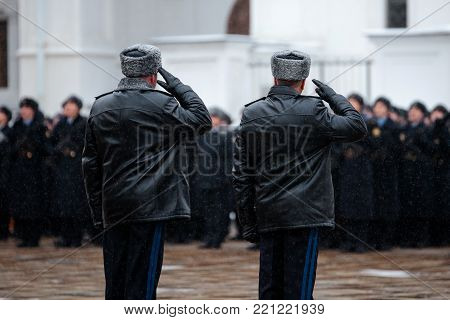 Two Russian army generasl. Salutation. Back view. Winter view.