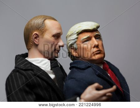 NEW JERSEY, USA - JAN 4 2018: Caricature of Russian President Vladimir Putin whispering into the ear of United States President Donald Trump - using toy action figures