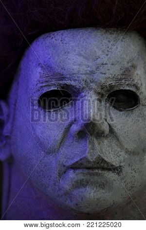 NEW JERSEY, USA - JAN 4 2018: Close up of Michael Myers mask in one sixth scale using selective focus. Minature created by Ones Customs. Slasher from the John Carpenter's Halloween movie franchise.
