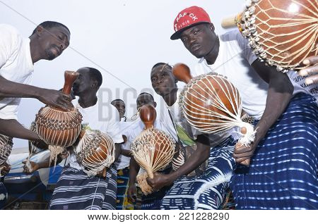 yamoussoukro, ivory coast - Oclober 02, 2015: ivorian local musicians make the traditional African sounds with the drums in yamoussoukro, ivory coast