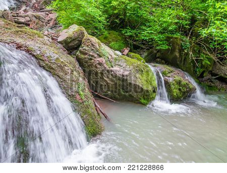 Flowing Down From The Rocks, The Streams Merge Into A Small Pond.