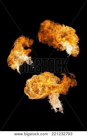 Fire ball explosion from bottom to top. Fire flamethrower isolated on black