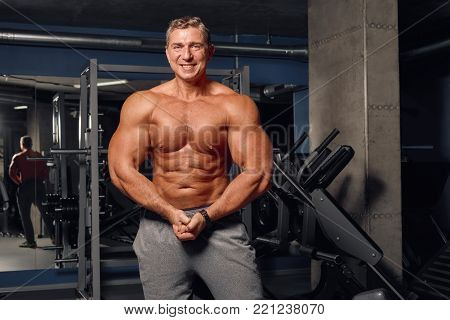Adult Man Shows His Athletic, Inflated Body.