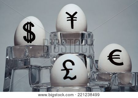 The inscription on chicken eggs for advertising and promotion of various currencies and crypto. Written or drawn symbols British pound sterling. dollar. Euro. Japanese Yen.