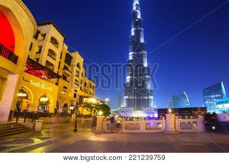 DUBAI, UAE - 1 APRIL 2014: Downtown of Dubai with Burj Khalifa building at dusk, UAE. Dubai is the most populous city in the United Arab Emirates with 2,1 million people.