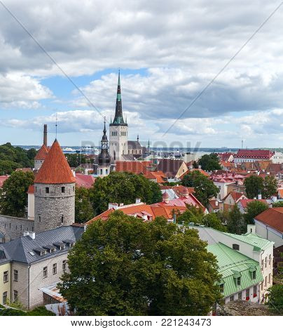 view from above of the ancient part of the city of Tallinn. Typical red tiled roofs. Estonia. Stock photo