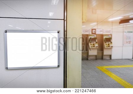 blank advertising billboard or light box showcase with ticket vending machine background at train station, copy space for your text message or media content, commercial and marketing concept