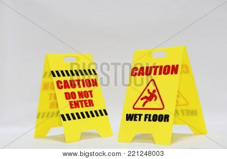 Caution Do Not Enter And Wet Floor Signage