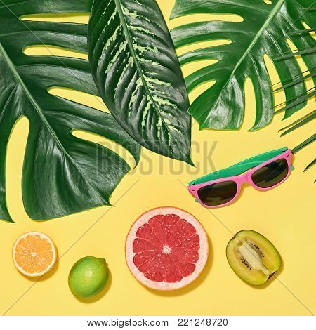 Tropical Palm Leaves, Fresh Fruits. Colorful Hot Summer Vibes. Trendy Sunglasses, Creative Bright summer background, Beach. Fashion concept. Minimal art