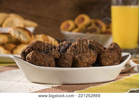 Kibe roast. Brazilian snack on wood background. Salgadinhos.