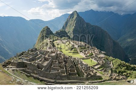 Machu Picchu, Peru - September 2017: View of the Lost Incan City of Machu Picchu near Cusco, Peru. Machu Picchu is a Peruvian Historical Sanctuary and a UNESCO World Heritage Site.