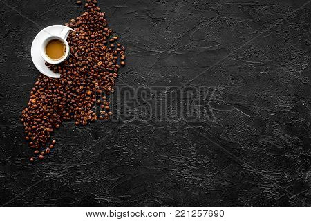 Cup of milky coffee on black table top view copy space. Coffee background
