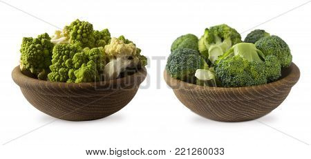 Broccoli and Roman cauliflower in wooden bowl isolated on white background. Cauliflower close up. Fractal texture of romanesco broccoli. Roman cauliflower with copy space for text.