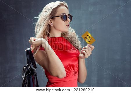Elegant Young Woman Holds Vip Member Card In Hand