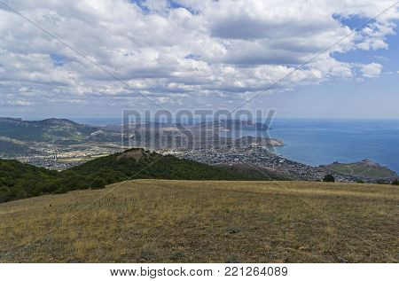 View from the top of the mountain Perchem (the highest mountain in the vicinity of the city of Sudak) in the direction of the Sudak and  Kapsel bays. Crimea.