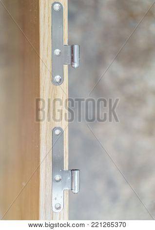 Closeup of iron hinges in wooden door