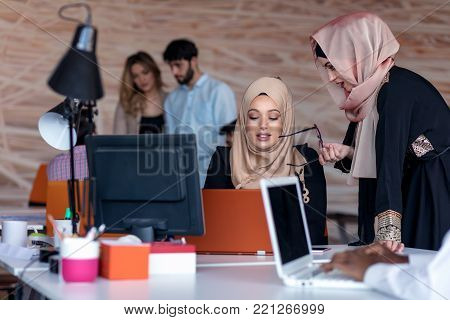 Startup business people group working everyday job at modern office. Tech office, tech company, tech startup, tech team.