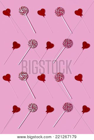 Lolly pop lines pattern on a pink background. Valentines concept.