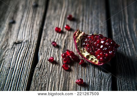 Fresh red pomegranate and grapefruit On a wooden background. Pomegranate in plate on wood background. Pomegranate on wood textured background. Overhead view image. a