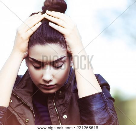 Sad depressed young teen woman outdoors