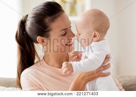 family, motherhood and people concept - happy mother with little baby boy at home