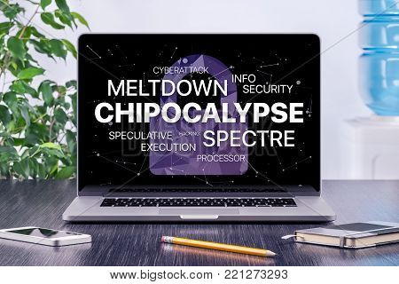 Chipocalypse concept with meltdown and spectre threat. Chipocalypse meltdown and spectre threat on laptop screen in office workplace.