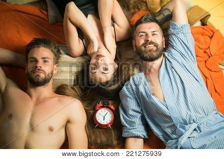 people lovers sleep at alarm clock, time. Swinger relations, relax, wake up. Family trust, polygamy, betrayal. men and woman with long hair, lover. Love triangle and romance, perfect morning. friends