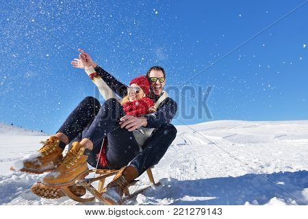 romantic winter scene, happy young couple having fun on fresh show on winter vacatio, mountain nature landscape.