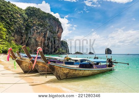 Amazing view of beautiful beach with longtale boats. Location: Railay beach, Krabi, Thailand, Andaman Sea. Artistic picture.