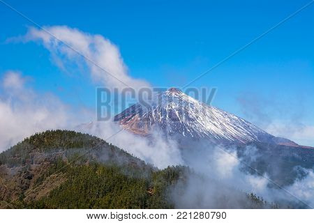 Beautiful view of famous volcano Teide on a sunny day with clouds, Teide National Park, Tenerife, Canary Islands, Spain