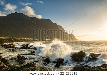 Amazing view of beach in Buenavista del Norte near golf course with high cliffs on the sunset. Location: Buenavista del Norte, Tenerife, Canary Islands. Artistic picture. Beauty world.