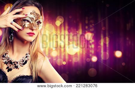 Attractive Model Woman Wearing Gold Carnival Mask