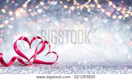 Valentines Card - Red Ribbon Shaped Hearts On Silver Shiny Background With Lights