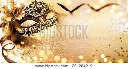 Venetian Golden Mask On Shiny Defocused Background
