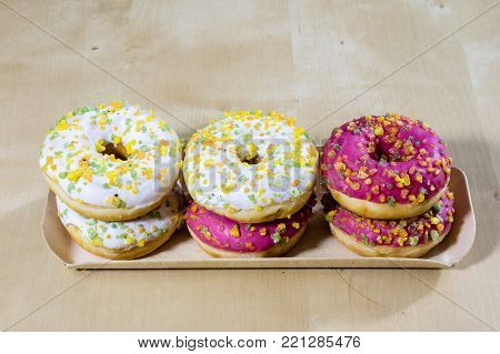 Tasty And Fresh Donuts On The Kitchen Table. Cookies, Tasty Snacks On A Wooden Table. Table In Kuchi