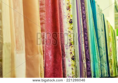 Colorful Rainbow of Fabrics in a Vertical Row