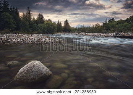 Bela River with Krivan Peak in Background at Sunset in Slovakia