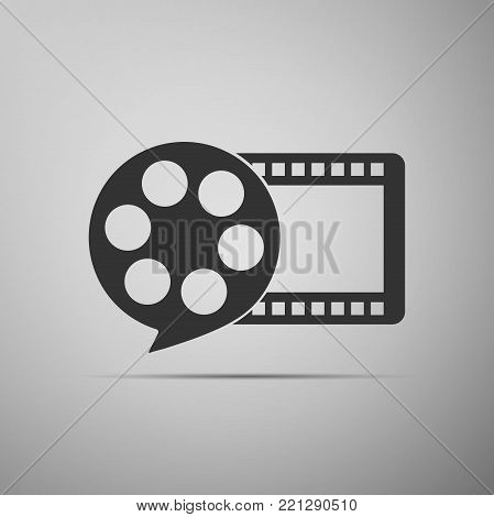 Film reel and play video movie film icon isolated on grey background. Flat design. Vector Illustration