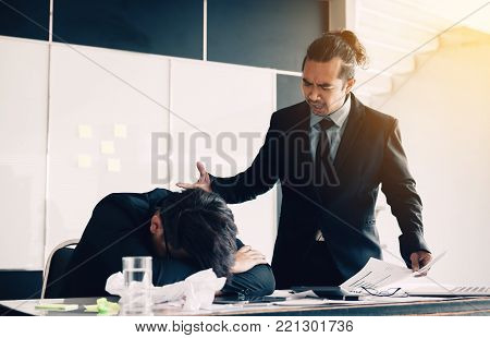 Manager reprimanding an employee in an office