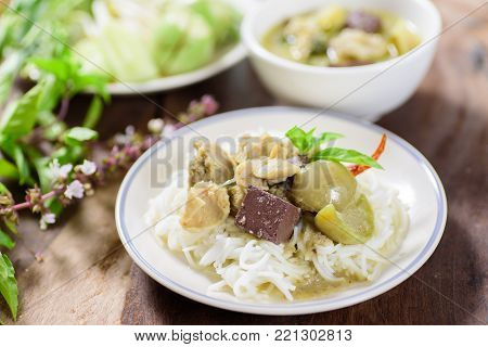 Thai food, rice vermicelli noodles with green curry chicken