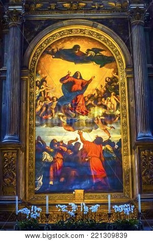VENICE, iTALY - SEPTEMBER 21, 2017 Titian Assumption Virgin Mary Rise to Heaven  Painting Santa Maria Gloriosa de Frari Church San Polo Venice Italy.  Church completed mid 1400s.  Titian Painted Assumption Mary Rise to Heaven Painting in 1518