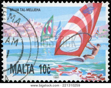 MALTA - CIRCA 1991: A stamp printed in Malta, shows windsurfing in Mellieha Bay, circa 1991.