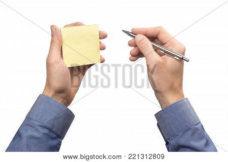 Man in a shirt holds an office sticker for taking notes of yellow in one hand and a pen in the other hand. Isolated on a white background. mockup