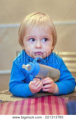 cute baby at the table waiting for lunch