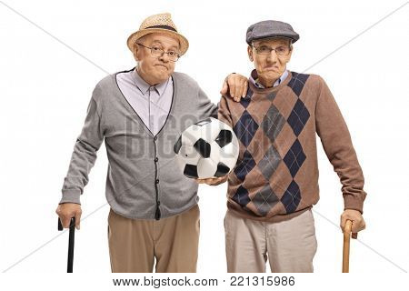 Disappointed seniors holding a deflated football isolated on white background