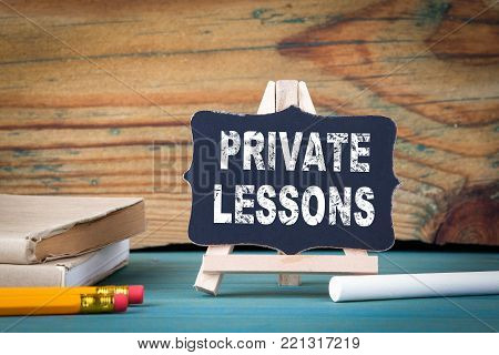 Private Lessons, education concept. small wooden board with chalk on the table.